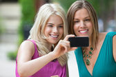 Female Friends Photographing Themselves — Stock Photo