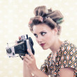 Woman holding Vintage 4x6 Film Camera — Stock Photo #12765361