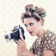Woman holding Vintage 4x6 Film Camera - Stock Photo