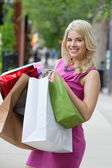 Happy Shopaholic Woman — Stock Photo