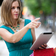 Stock Photo: Shopping Womwith Digital Tablet
