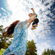 Mother Throwing Daughter in Air - Stock Photo