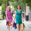 Women With Shopping Bags On Sidewalk — Stock Photo