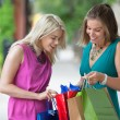 Friends Looking Into Shopping Bags — Stock Photo