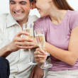 Couple Having Champagne - Stock Photo
