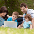 Family Outdoors with Computer — 图库照片