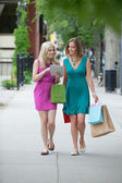 Female Friends With Shopping Bags Using Digital Tablet — Stok fotoğraf