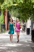 Female Friends Walking On Sidewalk — Stock Photo