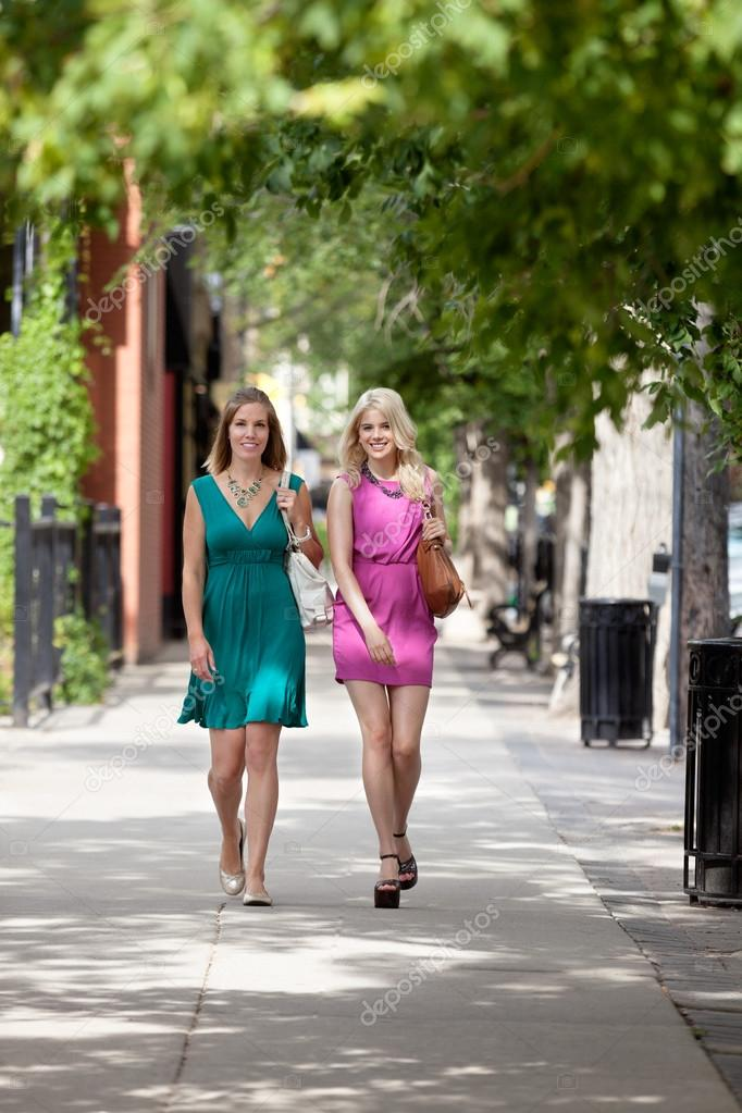 Full length portrait of young women walking on sidewalk — Stock Photo #12807379