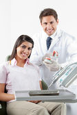Dentist And Patient With Teeth Model In Clinic — Stock Photo