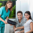 Dentist Showing Dental X-Ray To Couple — Stock Photo