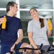 Stock Photo: Happy Man And Woman Holding Juice Bottles