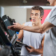 Man Asking About Machines In Gym — Stock Photo