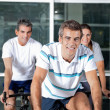 On Spinning Bike In Health Club — Stock Photo