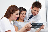 Female Nurse And Dentist Explaining X-Ray Report To Patient — Stock Photo