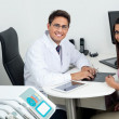 Happy Dentist And Patient At Office Desk — Stok fotoğraf