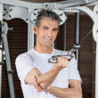 Man Working Out In Fitness Center - Stock Photo
