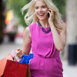 Stock Photo: Shopaholic Woman On A Call