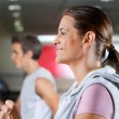 WomAnd MRunning On Treadmill — Stock Photo #13134178