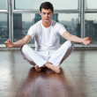 Young Man Meditating On Wooden Floor — Stock Photo