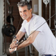 Mature Man Working Out In Fitness Center - 