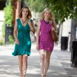 Young Friends Walking On Sidewalk — Stock Photo #13136449