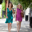 Stock Photo: Young Friends Walking On Sidewalk