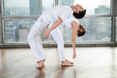 Male Yoga Instructor Assisting Woman — Stock Photo