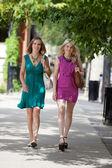 Young Friends Walking On Sidewalk — Stock Photo