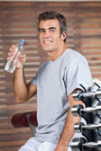 Happy Man Drinking Water From Bottle At Health Club — Stock Photo