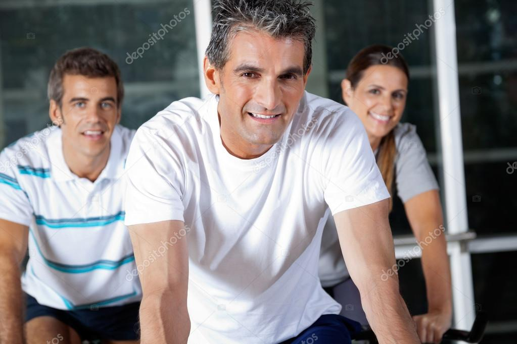 Portrait of happy friends in health club — Stock Photo #13140704