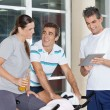 Stock Photo: Friends Using Digital Tablet In Gym