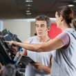 Stock Photo: WomAsking About Machines In Gym