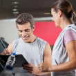 Stock Photo: Instructor With Client In Health Club