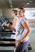 Woman And Man Running On Treadmill — Stock Photo