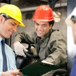 Workers And Supervisors At Warehouse — Stockfoto
