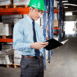 Supervisor Reading Book At Warehouse — Stock Photo