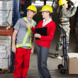 Supervisor Instructing ForemAt Warehouse — Stock Photo #14165530