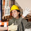Stock Photo: ForemWith Coworker Lifting Cardboard Box At Warehouse
