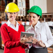 Royalty-Free Stock Photo: Female Supervisor With Colleague At Warehouse
