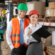 Two Confident Young Supervisors At Warehouse - Foto Stock