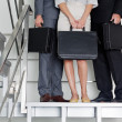 Stock Photo: Businesspeople With Briefcases Standing On Steps