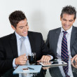 Royalty-Free Stock Photo: Businessmen Using Digital Tablet In Office