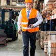 Supervisor In A Hurry At Warehouse - Stock Photo