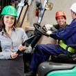 Confident Female Supervisor With Forklift Driver At Warehouse — Stock Photo #14168140