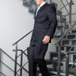 Businessman Walking Down The Stairs — Stock Photo