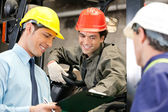 Workers And Supervisors At Warehouse — Foto Stock