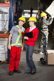 Supervisor Instructing Foreman At Warehouse — Stock Photo