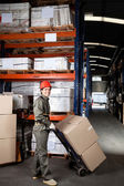 Foreman Pushing Handtruck With Cardboard Boxes — Stock Photo