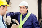 Forklift Driver Looking At Supervisor — Stockfoto